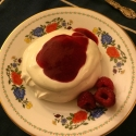 Individual Pavlovas with fresh whipped cream and raspberry coulis! Delicious!